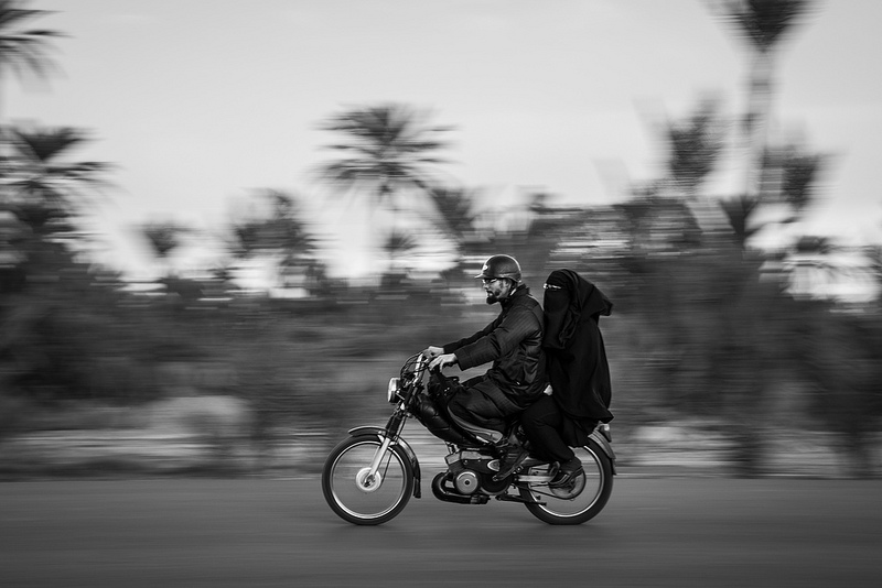 Muslim couple on motorcycle