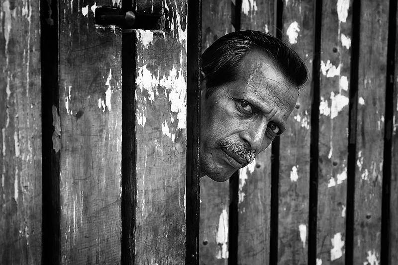 man behind fence