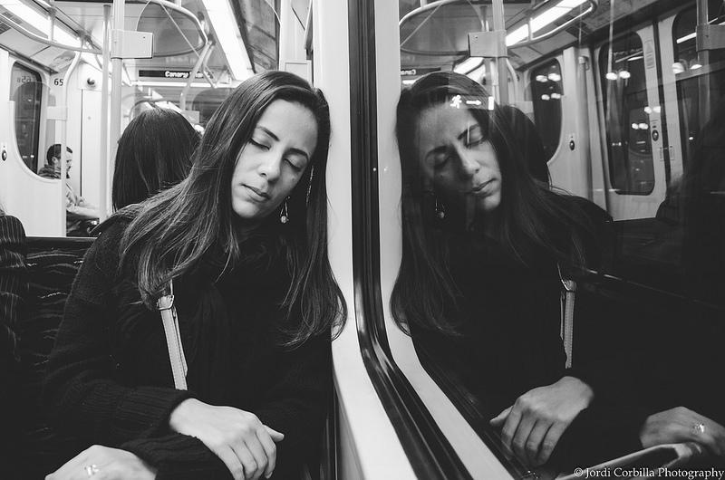 woman sleeping on subway