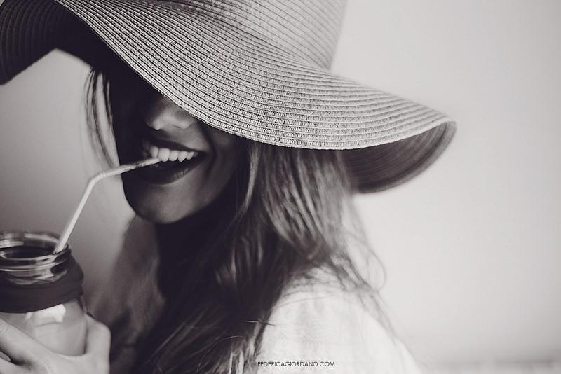 woman in wide brimmed hat