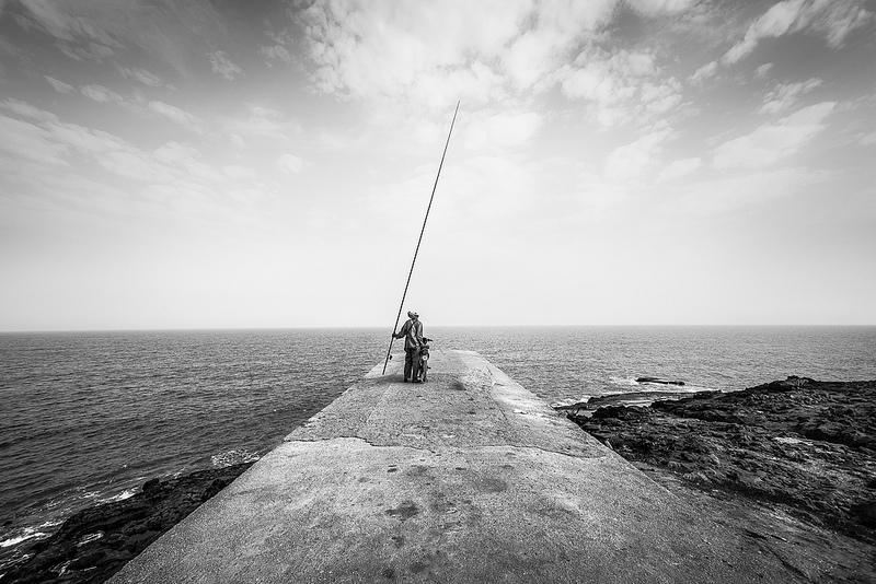 black and white fisherman