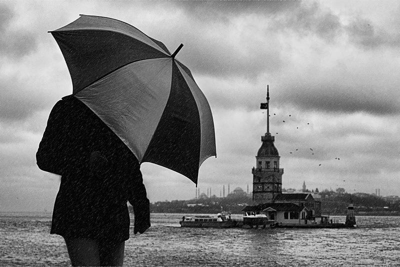 man holding umbrella